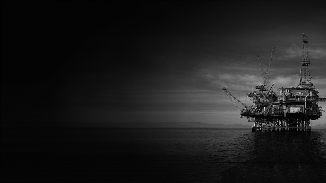 Oil Workers at Dusk