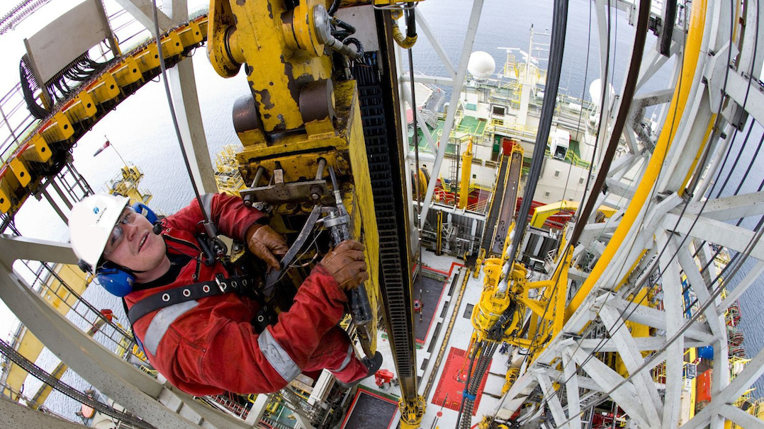 Driller inspects the top drive on drilling rig Stena Don.